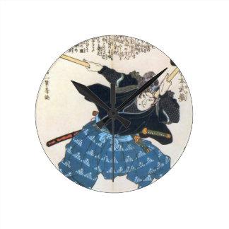 宮本武蔵 de Musashi Miyamoto avec deux Bokken Horloge Ronde