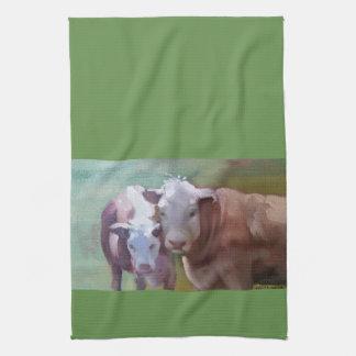 2 vaches dans une serviette de cuisine de paysage