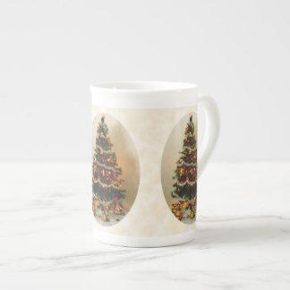 Ah, tasse de porcelaine tendre d'arbre de Noël