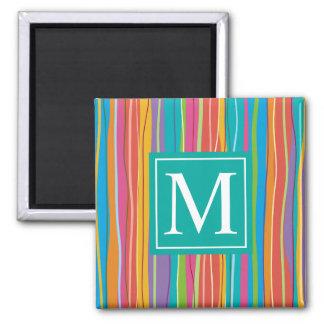 Aimant abstrait coloré doux du monogramme |