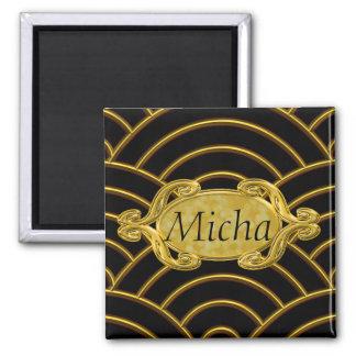Aimant Monogramme métallique de voûtes d'or