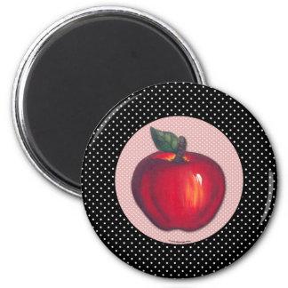 Aimant Pommes rouges blanches sur le pois noir