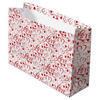 Amour cursif et sac rouge de Saint-Valentin de