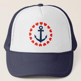 Ancre nautique avec le casquette de navigation des