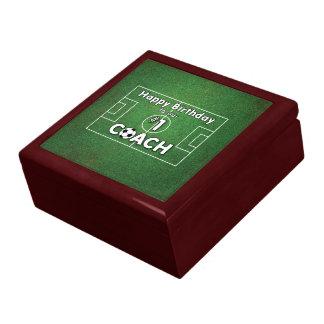 Anniversaire d'entraîneur du football avec le boîte à souvenirs