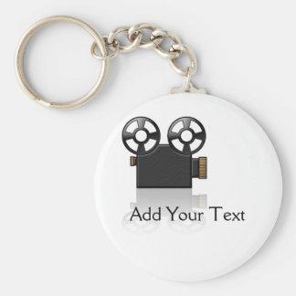 Appareil-photo de film dans le noir et or sur le porte-clé rond