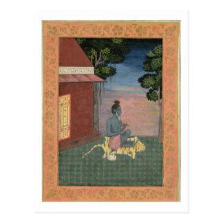 Ascétique âgé assis sur une peau de tigre en carte postale