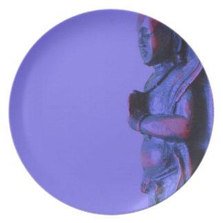 Assiette Bouddha découpé par main bleue