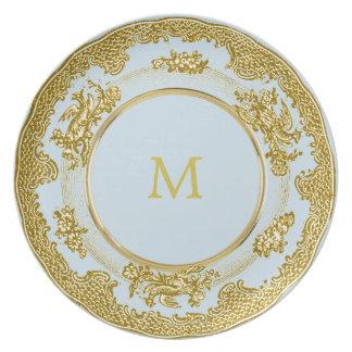 Assiette initiale antique vintage de style d'or