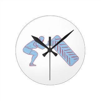Athlète de forme physique refoulant le dessin de horloge ronde