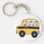 Autobus scolaire avec le T-shirts et les cadeaux d Porte-clés