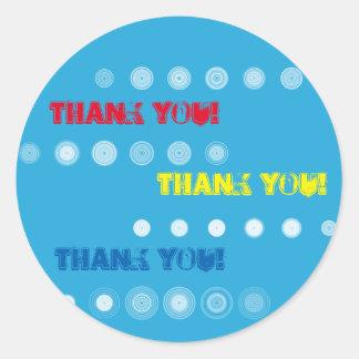 Autocollant jaune et bleu rouge de cercle de Merci
