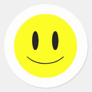 Autocollant souriant de visage