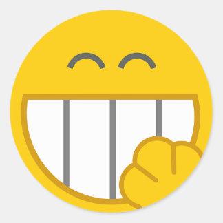Autocollant souriant riant jaune mignon de visage