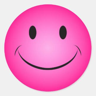 Autocollant souriant rose de visage