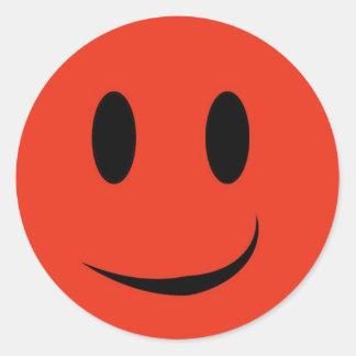 Autocollant souriant rouge de visage