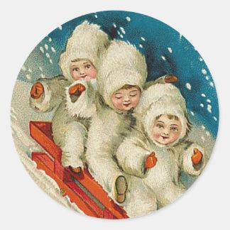 Autocollant victorien de Noël de bébé de neige