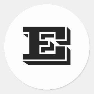 Autocollants ronds blancs de police de la lettre E