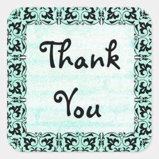 Autocollants turquoises et noirs de Merci