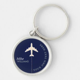 avion sur le porte - clé bleu avec le nom porte-clé rond argenté
