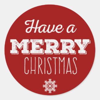 Ayez un autocollant rond de Joyeux Noël