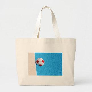ballon de plage Rouge-blanc flottant dans la Grand Tote Bag
