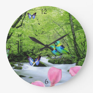 Beaux oiseaux et horloge de paysage de papillons