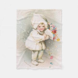 Bébé de neige d'hiver et couverture antiques