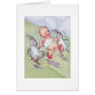 Bébé vintage et carte de Pâques de lapins de