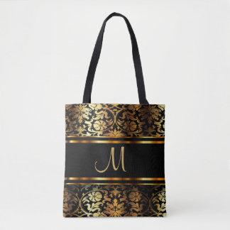 Bel or et conception noire de damassé sac