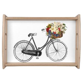 Bicyclette avec le plateau de fleurs
