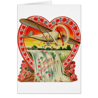 Biplan vintage au-dessus de carte de Valentine de
