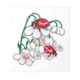 Bloc-note coccinelles sur des flors