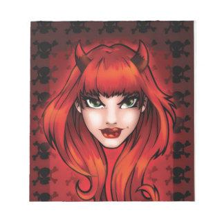 Bloc-note Petite fille de diable avec le fond de crânes