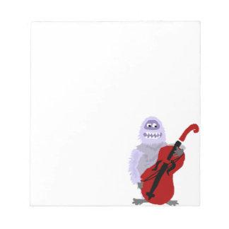 Bonhomme de neige abominable mignon drôle avec le bloc-note