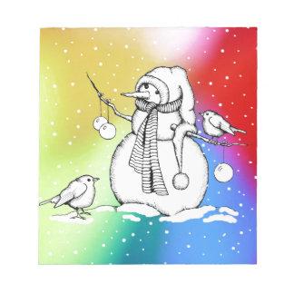 Bonhomme de neige sur l'arrière - plan bloc-note