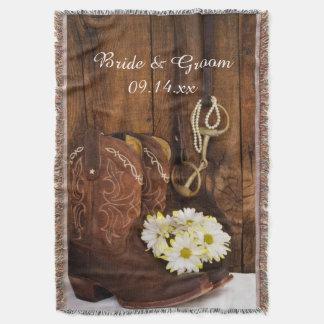 Bottes de cowboy, mariage campagnard de peu de couvre pied de lit