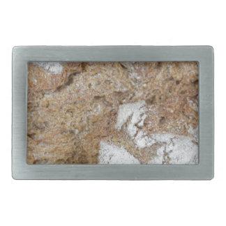 Boucles De Ceinture Rectangulaires Macro photo de la surface du pain brun