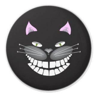 Bouton de sourire de chat de Cheshire