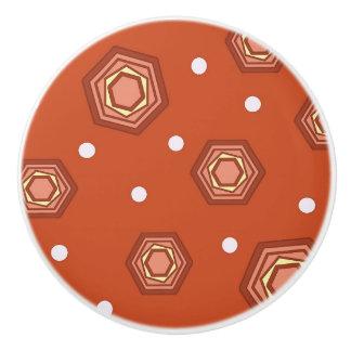 Bouton en céramique orange de traction brûlé par