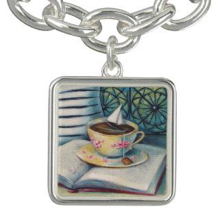 Bracelet argenté de charme de livre et de voilier
