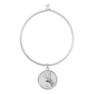 Bracelet Rigide Noir sur la silhouette blanche d'oiseau -