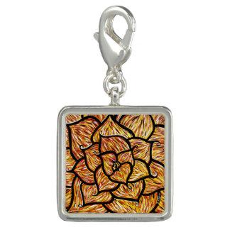Breloque Fleur orange abstraite