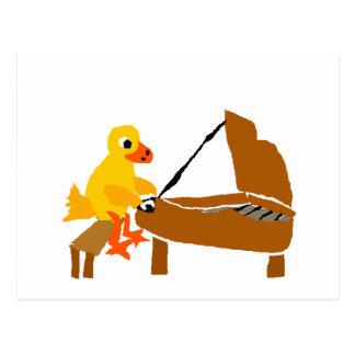 Canard drôle jouant l'art de piano carte postale