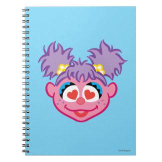 Carnet Visage de sourire d'Abby avec les yeux en forme de