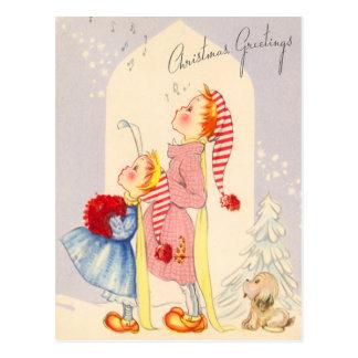 Carolers chanteurs mignons de Noël carte postale