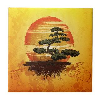 Carreau Coucher du soleil japonais d'arbre de bonsaïs