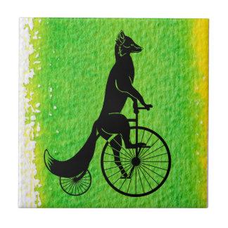 Carreau Fox montant un vélo