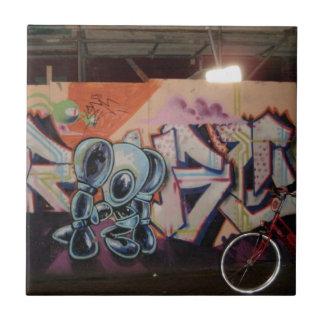 Carreau L'AMS de vélo et de graffiti