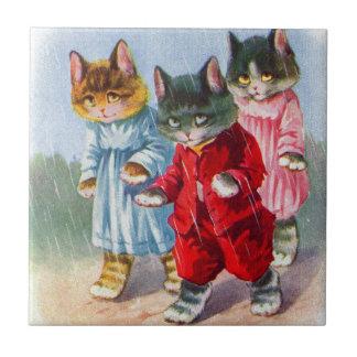Carreau les années 1930 ont habillé des chatons sous la